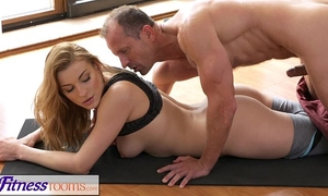 Fitnessrooms yoga slaver teaches youthful student raunchy techniques