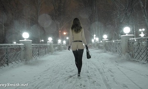 Jeny smith exposed in snow fall walking throughout the town