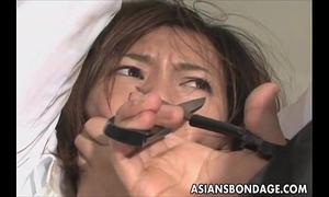 Cute oriental sweetheart in electro play slavery scene