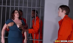 Busty mamma maggie green takes 2 bbcs in a jail